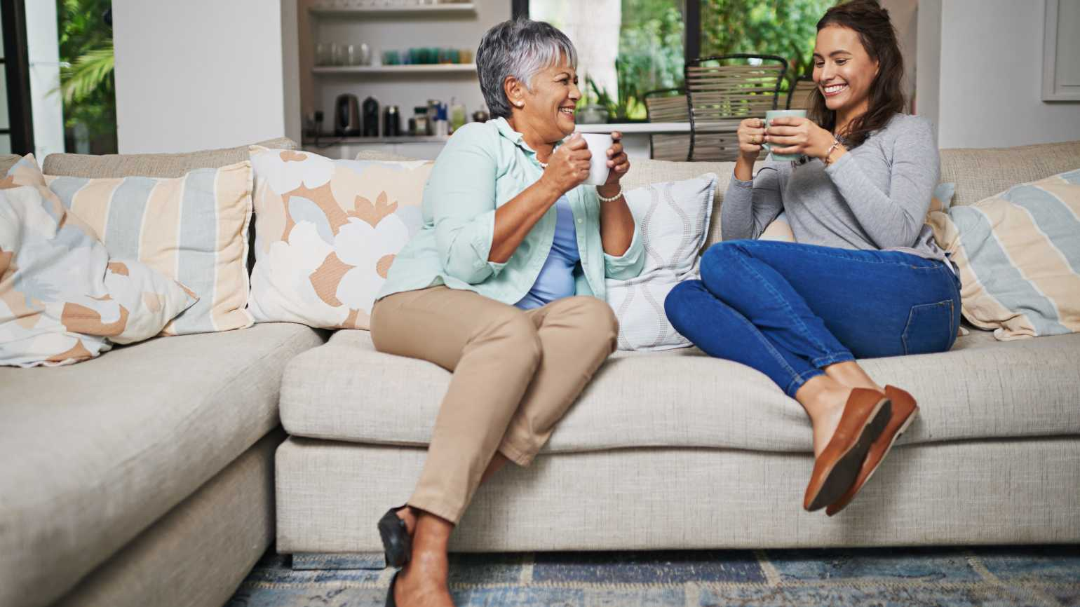 adult_child_talking_to_mom_on_couch 91024