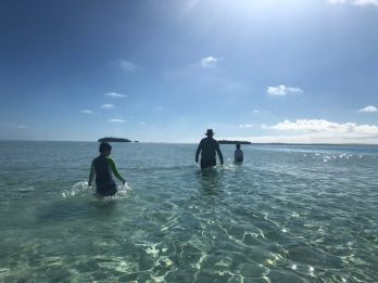 Cade, Ella and me wading across the Aitutaki lagoon